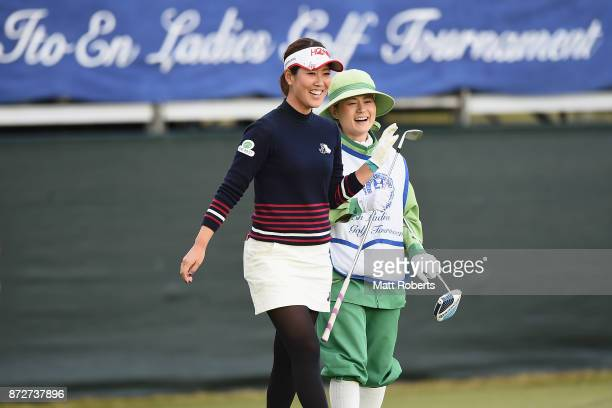 Mami Fukuda of Japan reacts with her caddie on the 18th green during the second round of the Itoen Ladies Golf Tournament 2017 at the Great Island...