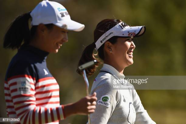 Mami Fukuda of Japan shares a laugh with Phoebe Yao of Taiwan during the final round of the Itoen Ladies Golf Tournament 2017 at the Great Island...