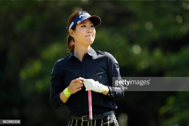 Mami Fukuda of Japan watches her tee shot on the first hole during the final round of the CyberAgent Ladies Golf Tournament at Grand fields Country...