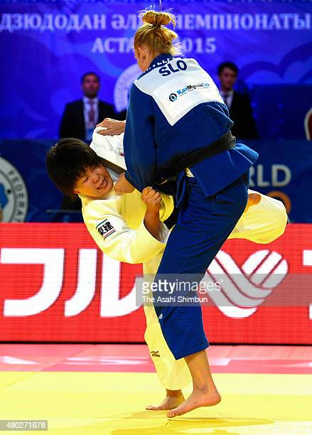 Mami Umeki of Japan and Anamari Velensek of Slovenia compete in the Women's 78kg final during the 2015 Astana World Judo Championships at the Alau...