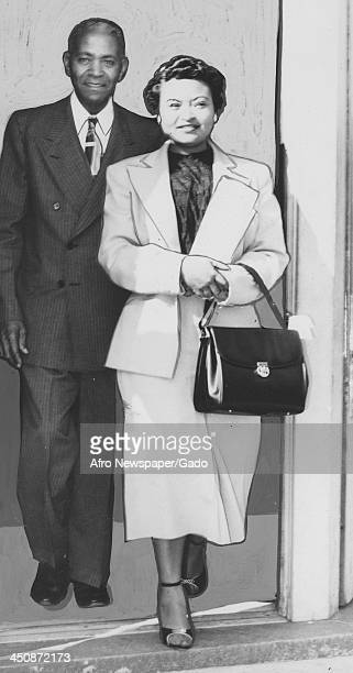 Mamie Bradley mother of lynched teenager Emmett Till exits the Afro American Newspapers office with her father 1955