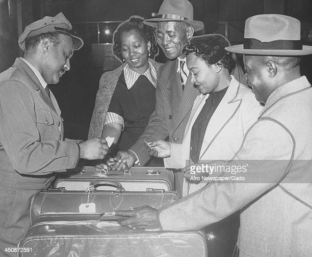 Mamie Bradley mother of lynched teenager Emmett Till receives her baggage at the Philadelphia International Airport before speaking at the NAACP...