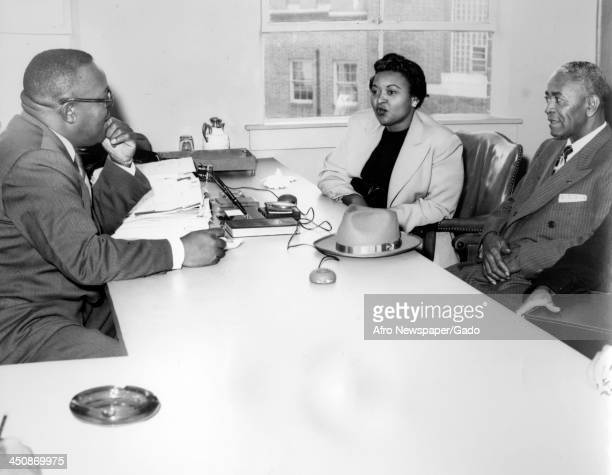 Mamie Bradley mother of lynched teenager Emmett Till speaks with her father and a police interviewer 1955