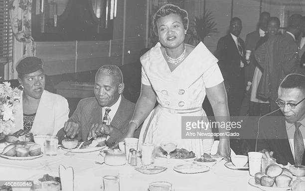 Mamie Bradley mother of lynched teenager Emmett Till stands with her father John Carson and the reporter who covered the Emmett Till trial Jimmy...