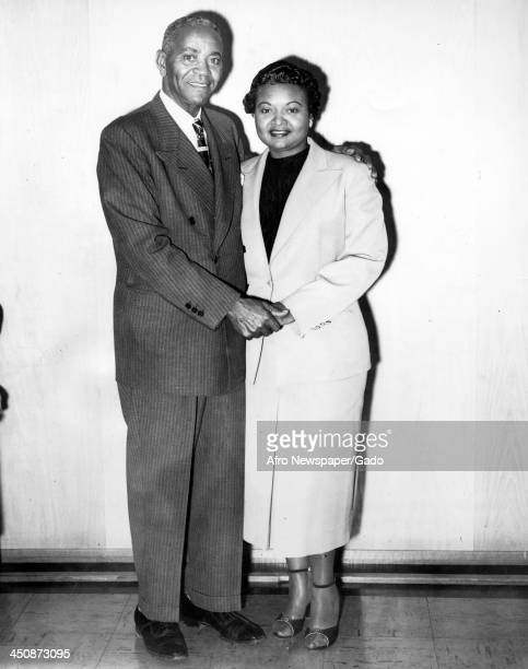 Mamie Bradley mother of lynched teenager Emmett Till stands with her father 1955