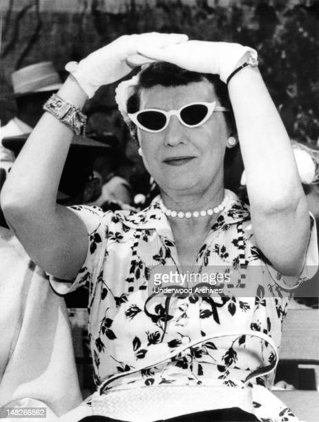 Mamie Eisenhower shields her eyes as she watches ceremonies at the US Military Academy West Point New York circa 1956
