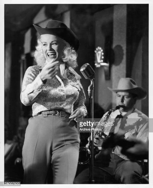 Mamie Van Doren and Kenneth Buker perform on the stage in a scene from the film 'Born Reckless' 1958