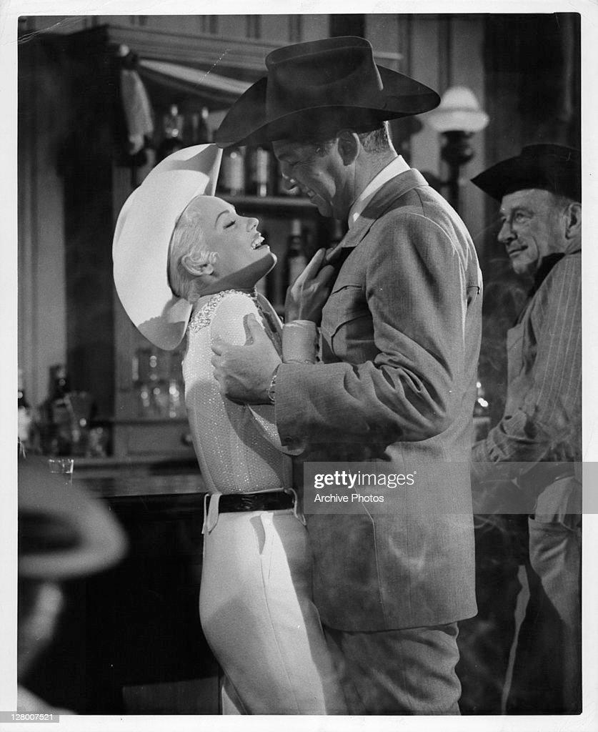 Mamie Van Doren is held by Tom Duggan in a scene from the