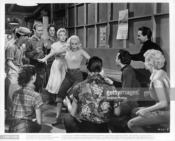 Mamie Van Doren performs in front of group of people in a scene from the film 'Untamed Youth' 1957