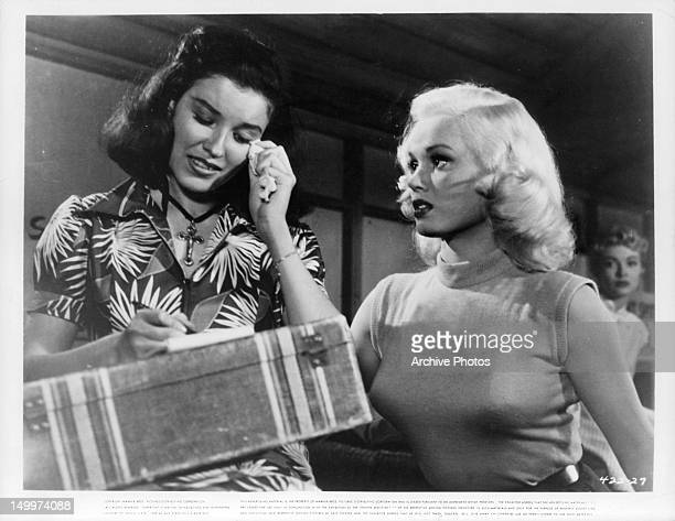 Mamie Van Doren watching woman tear up in a scene from the film 'Untamed Youth' 1957