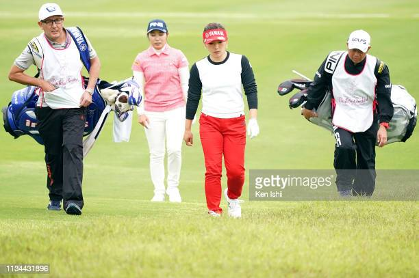 Mamiko Higa and Chie Arimura of Japan walks on the 7th hole during the second round of the Daikin Orchid Ladies Golf Tournament at Ryukyu Golf Club...
