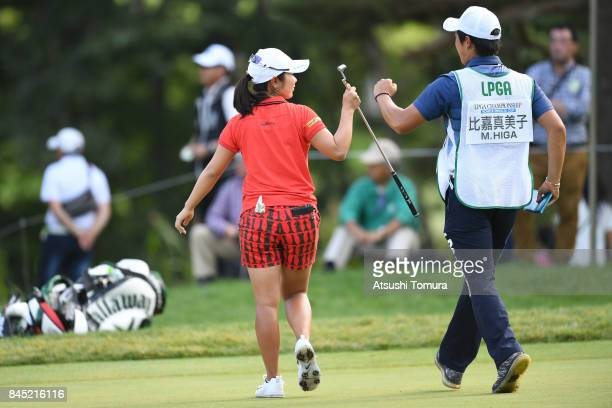 Mamiko Higa of Japan celebrates after making her birdie putt on the 15th hole during the final round of the 50th LPGA Championship Konica Minolta Cup...
