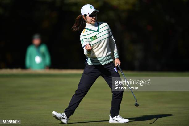 Mamiko Higa of Japan celebrates after making her birdie putt on the 10th hole during the third round of the Queens at Miyoshi Country Club on...
