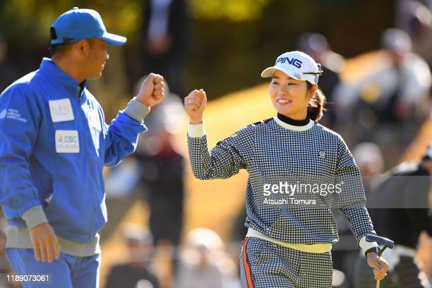 Mamiko Higa of Japan celebrates with her caddie after holing out with the eagle on the 9th green during the first round of the Daio Paper Elleair...