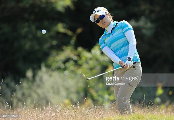 Mamiko Higa of Japan chips from the rough during a practice round prior to the Ricoh Women's British Open at Royal Birkdale on July 9 2014 in...