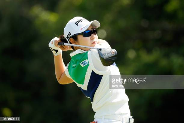 Mamiko Higa of Japan hits a tee shot on the first hole during the final round of the CyberAgent Ladies Golf Tournament at Grand fields Country Club...