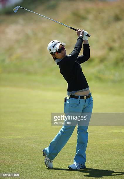 Mamiko Higa of Japan hits her 2nd shot on the 1st hole during the second round of the Ricoh Women's British Open at Royal Birkdale on July 11 2014 in...