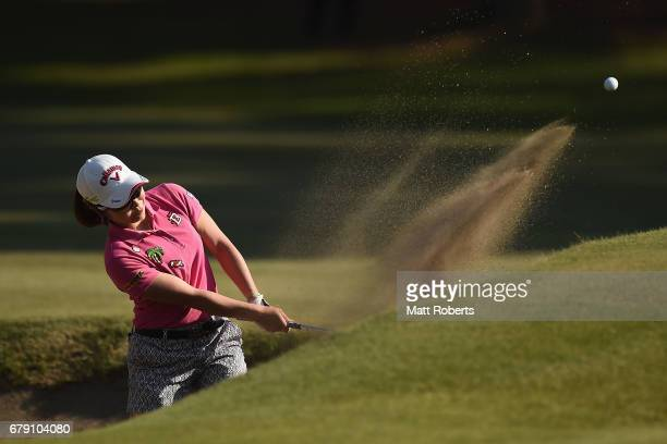 Mamiko Higa of Japan hits out of the 13th green bunker during the second round of the World Ladies Championship Salonpas Cup at the Ibaraki Golf Club...