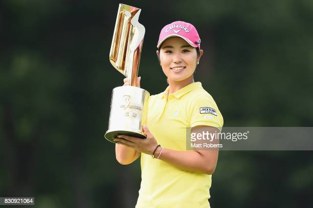 Mamiko Higa of Japan holds the winner trophy during the final round of the NEC Karuizawa 72 Golf Tournament 2017 at the Karuizawa 72 Golf North...