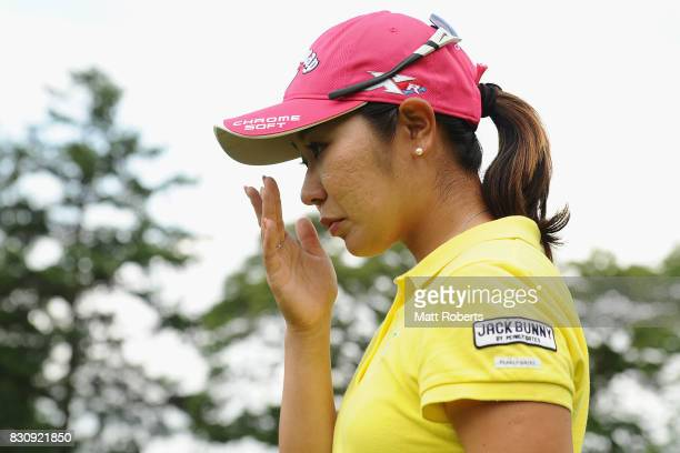 Mamiko Higa of Japan is seen wiping tears from her eyes after winning the final round of the NEC Karuizawa 72 Golf Tournament 2017 at the Karuizawa...