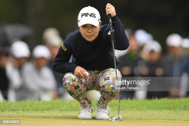 Mamiko Higa of Japan lines up her putt on the 9th hole during the final round of the KKT Cup Vantelin Ladies Open at the Kumamoto Kuko Country Club...