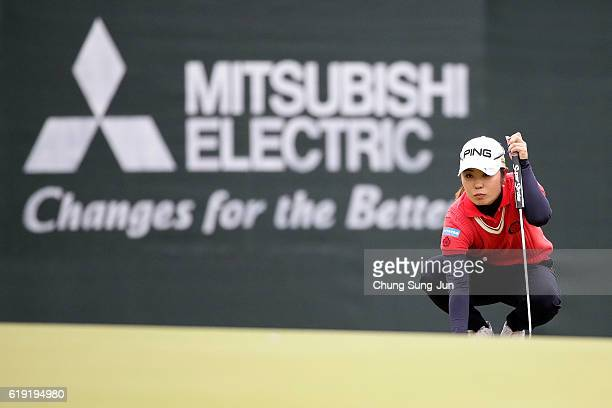 Mamiko Higa of Japan looks over a green on the 18th green during the final round of the Mitsubishi Electric/Hisako Higuchi Ladies Golf Tournament at...
