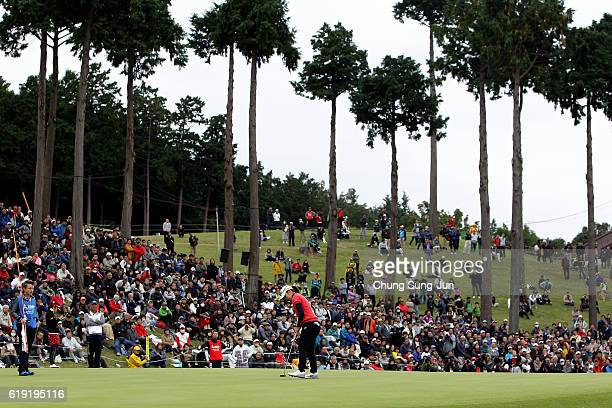 Mamiko Higa of Japan plays a putt on the 18th green during the final round of the Mitsubishi Electric/Hisako Higuchi Ladies Golf Tournament at the...