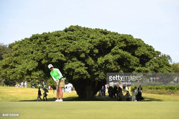 Mamiko Higa of Japan putts on the 17th hole during the final round of the Daikin Orchid Ladies Golf Tournament at the Ryukyu Golf Club on March 5...
