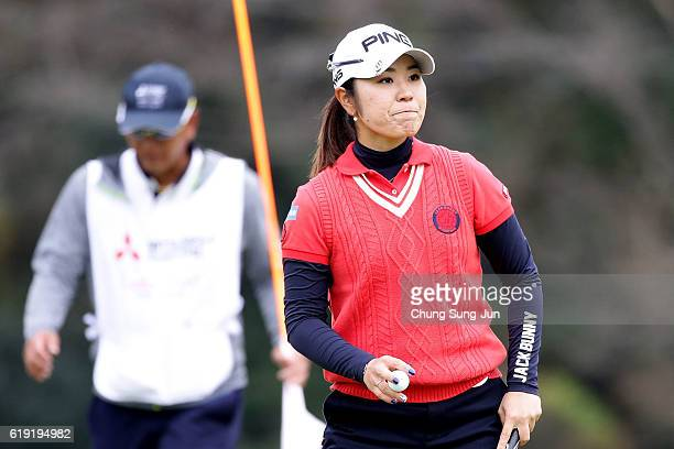 Mamiko Higa of Japan reacts after a putt on the 14th green during the final round of the Mitsubishi Electric/Hisako Higuchi Ladies Golf Tournament at...