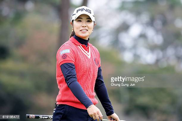 Mamiko Higa of Japan reacts after a putt on the 9th hole during the final round of the Mitsubishi Electric/Hisako Higuchi Ladies Golf Tournament at...