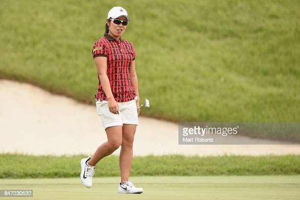 Mamiko Higa of Japan reacts after her putt during the first round of the Munsingwear Ladies Tokai Classic 2017 at the Shin Minami Aichi Country Club...