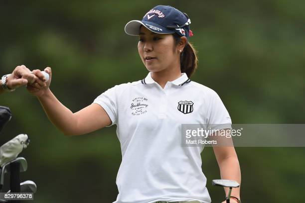 Mamiko Higa of Japan reacts after her putt on the first green during the first round of the NEC Karuizawa 72 Golf Tournament 2017 at the Karuizawa 72...