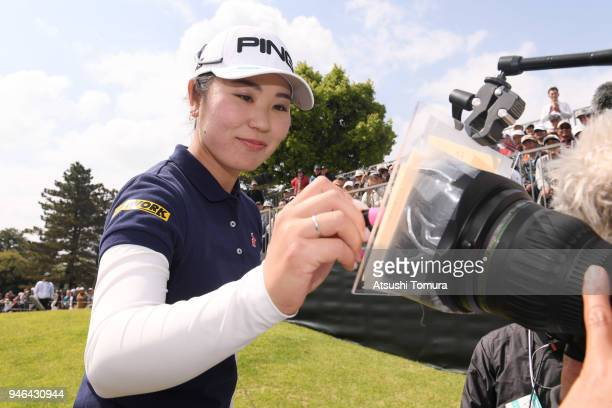 Mamiko Higa of Japan signs autograph on the TV camera after winning the KKT Cup Vantelin Ladies Open at the Kumamoto Kuko Country Club on April 15...