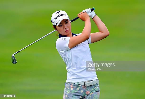 Mamiko Higa of Japan watches her shot on the 3rd hole during day four of the Sime Darby LPGA at Kuala Lumpur Golf Country Club on October 13 2013 in...