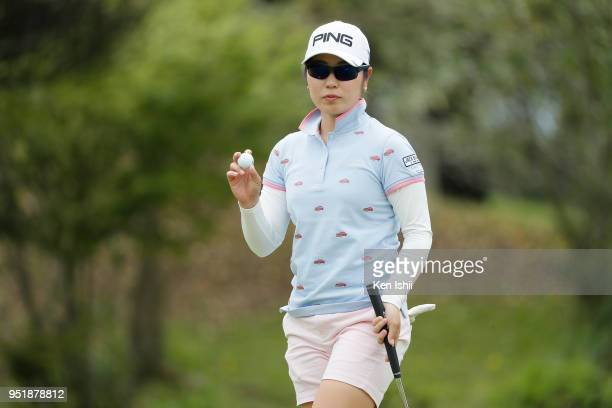 Mamiko Higa of Japan waves to the gallery on the 8th hole during the first round of the CyberAgent Ladies Golf Tournament at Grand fields Country...