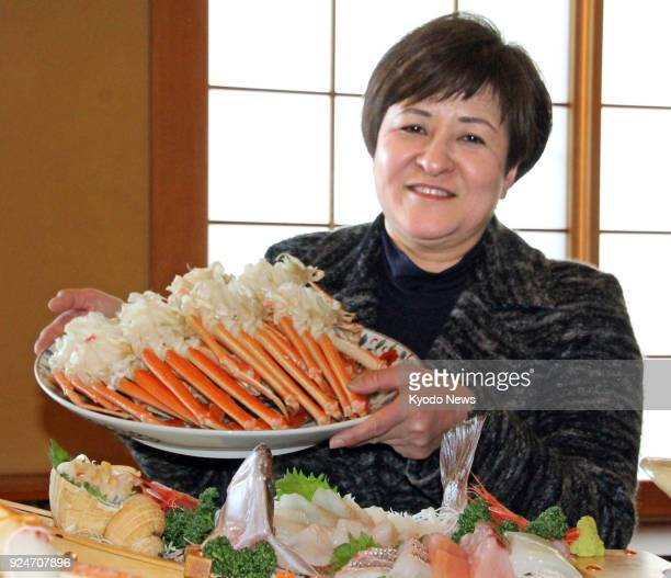 Mamiko Imamura who runs an inn in Echizen Fukui Prefecture shows off local specialty food Echizen crab on Feb 22 2018 ==Kyodo