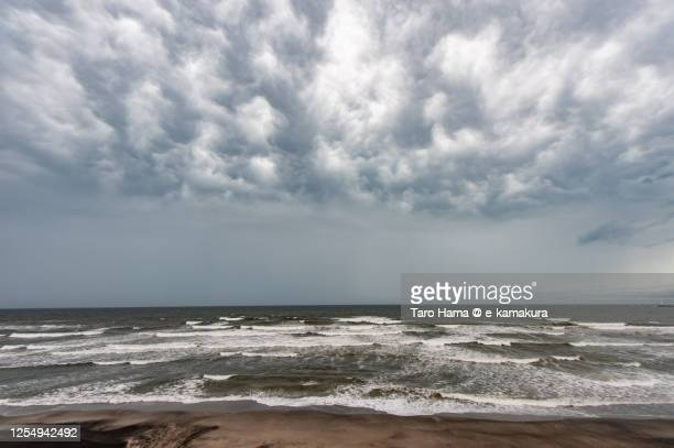 mammatus clouds on the beach in kanagawa prefecture of japan - taro hama ストックフォトと画像