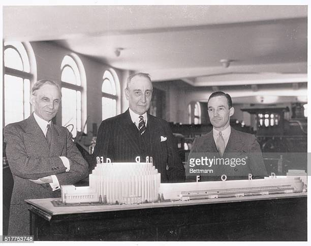 Mammoth Ford Exhibit for 1934 Chicago Fair. Chicago, Illinois: Henry Ford and Edsel Ford are showing Rufus C. Dawes , president of the World's Fair,...