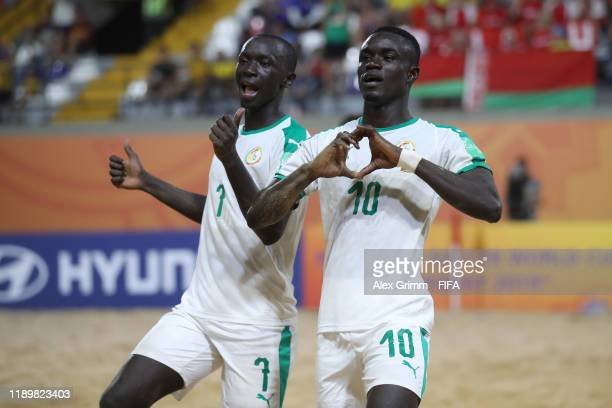 Mamour Diagne of Senegal celebrates a goal with team mate Babacar Fall during the FIFA Beach Soccer World Cup Paraguay 2019 group C match between...