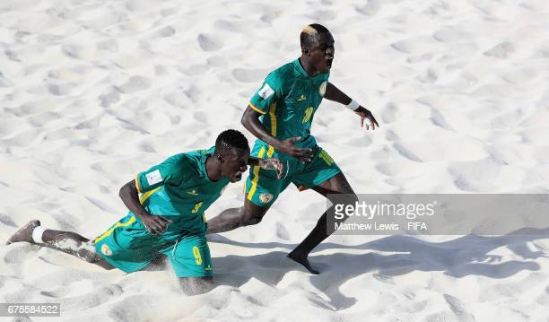 Mamour Diagne of Senegal celebrates his goal with Lansana Diassy during the FIFA Beach Soccer World Cup Bahamas 2017 group A match between...