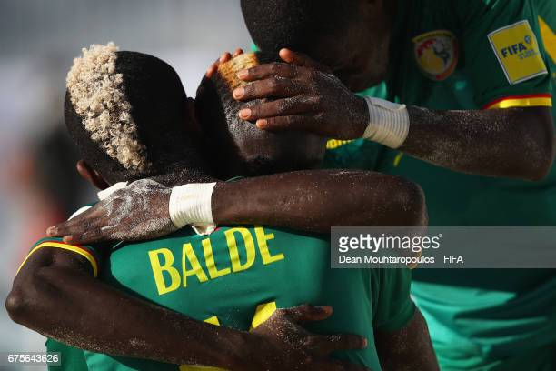 Mamour Diagne of Senegal celebrates scoring a goal with Ibrahima Balde during the FIFA Beach Soccer World Cup Bahamas 2017 group A match between...