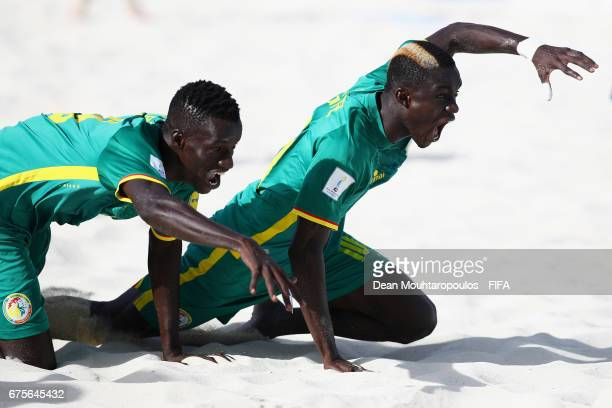 Mamour Diagne of Senegal celebrates scoring a goal with team mate Lansana Diassy during the FIFA Beach Soccer World Cup Bahamas 2017 group A match...