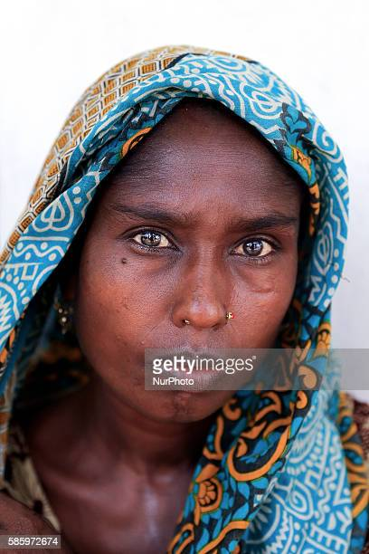 Mamtaj lost crops Her chickens were washed away by flood With her husband and son she is now in a madrasa for shelter Guthail Jamalpur