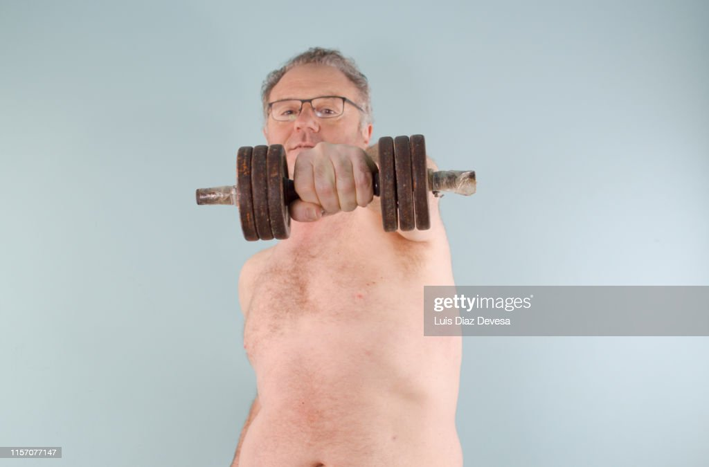Man 52 Year Old Lifting Weights Stock Photo - Getty Images