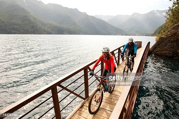 a man a woman bike riding. - attrezzatura sportiva foto e immagini stock