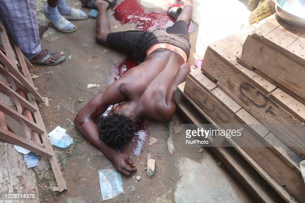 Man, Abayo Adeyemi, who was allegedly shot by police enforcing #EndSARS curfew, in pool of his blood in front of his residence along Lateef Jakande...