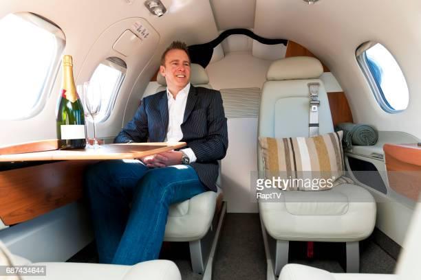 A man aboard a corporate jet.
