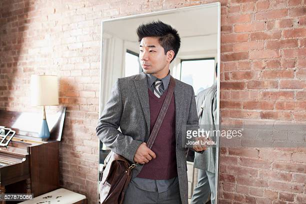Man about to leave house