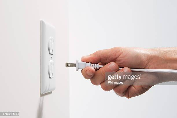 Man about to plug in