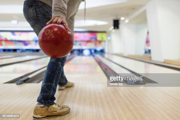 Man about to throw bowling ball
